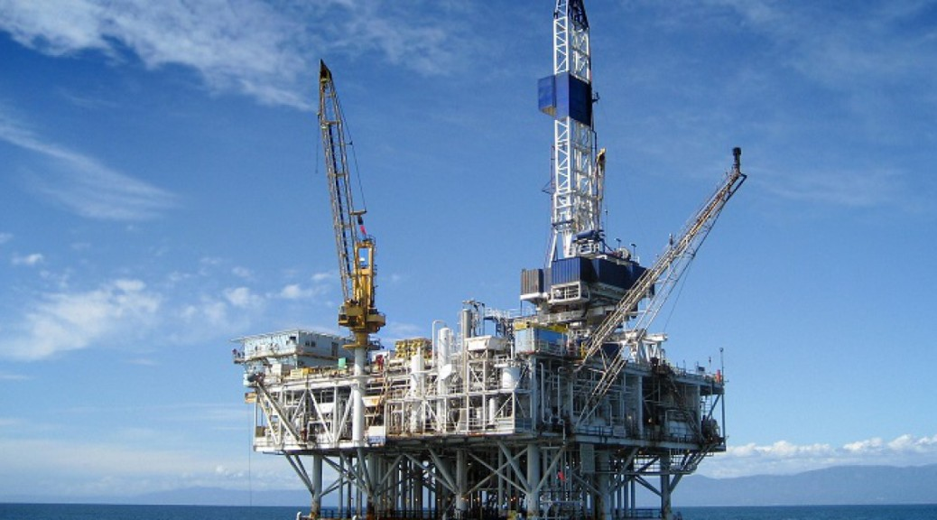 Large Pacific Ocean oil rig drilling platform off the southern coast of California.